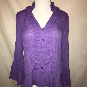 Sheer form-fitting crinkly purple blouse